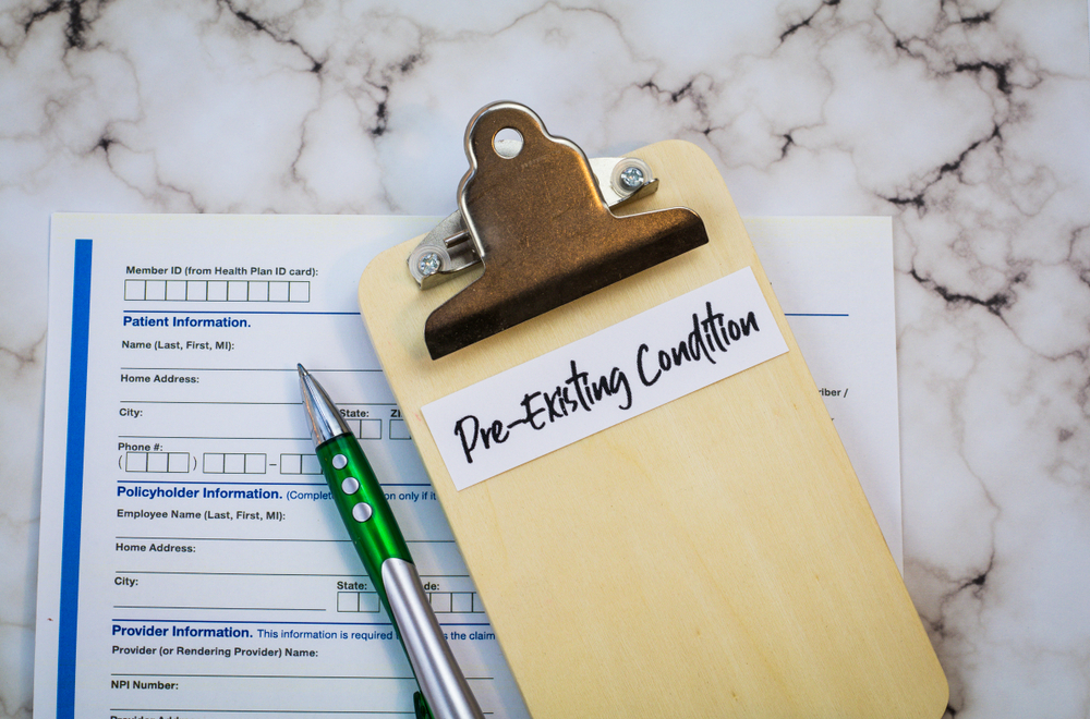 featured image showing a insurance form and Pre Existing Conditions
